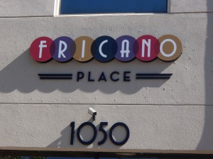 The Fricano's pizzeria that I frequent is located inside a larger building, which also contains a ice cream parlor.