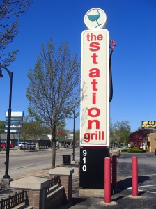 Showing off the gas station history, The Stations' sign mimics that of a gas station