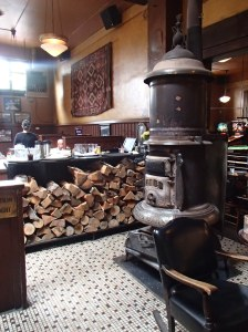 A wood-burning stove warms the already warm atmosphere in the Olympic Club