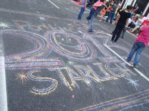 The streets were filled with side walk chalk art done by the kids awaiting the parade.