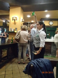 A picture of an escanciadora (person who pours Asturian Cider). Asutrian Cider is different because it has to be aerated in order to create the carbonation. It also has a flavor that is more distinct than regular cider. I have come to love it!