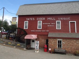 The exterior of Yates Cider Mill complete with the watermill that powers their apple pressing. Since Yates opened in 1863, 150 years ago, the mill has been powered by water.