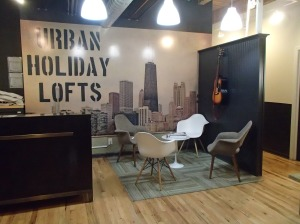 Urban Holiday Lofts - front desk and small lounge area