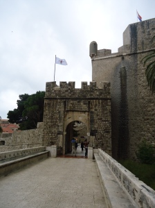 Entering the city, you pass through the large doors of the medieval walls.