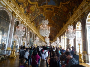The Hall of Mirrors, filled with tourists. Today, this hall is still  used for some of France's political meetings