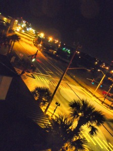 Street view from our timeshare -- loving the palm trees!